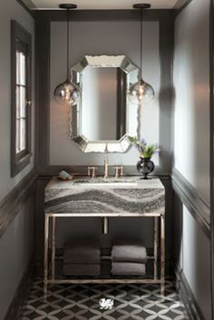 Looking to break the rules in your next bathroom reno? With our Roxwell design, we pair brushed bronze, gold, and silver finishes for a modern take on metallics in this powder bathroom remodel. Learn more about modern trends for mixing metals. Shabby, Bathroom Inspiration, Bathroom Ideas, Bathroom Mirrors, Funny Bathroom, Bathroom Signs, White Bathroom, Beautiful Bathrooms, Glamorous Bathroom