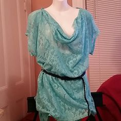 Mint colored 3x lace top with lining A nice lace top, great for the warm weather we will have soon or that school vacation get away many of you will be taking to Florida and the islands real soon. Jonathan Martin Tops Blouses