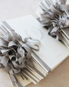 M i c h a e l a M c B r i d e: Stacks of pretty Order of Service booklets, tied in silk
