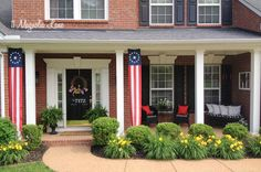 """""""Red, White, and Blue Front Porch for Memorial Day"""" -- Love the look of the long flag banners with the porch columns!!"""