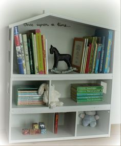 Recycled Lundby dollhouse is now a bookshelf in the baby's room