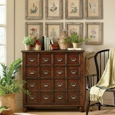 Stow fine china and table linens in vintaged style with this handsome apothecary chest, featuring intricate silver-toned handles and a distressed cherry finish.