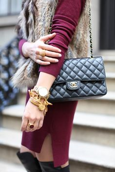 """The """"arm party"""" done right. Like the big boyfriend watch (silver) mixed with chunky gold pieces."""