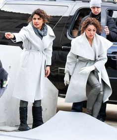 Slide 2 of 22: Priyanka Chopra and her stunt double, Aja Frary, scope out the Brooklyn, New York set of Quantico ahead of filming their scenes.