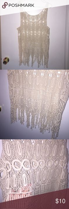 Crochet Lace Tank Top Crochet lace tank top. Color: off white. Size M (no tag). Fringe at the bottom. See through, would need to wear a bralette or tank top under it. Tops Tank Tops