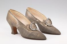 Evening Pumps by PIETRO YANTORNY  +++  While Yantorny's clientele came from all over the world, the majority were Americans, where the country's size and prosperity provided for an unparalleled number of the elegantly dressed customers he required. This pair was made for Mrs. Edward G. Sparrow (née Catherine D. Groth) of New York, whose husband's family had vast timber holdings in Lansing, Michigan. Metallic fabrics and leathers were an important element of evening shoes of the 1910s and…