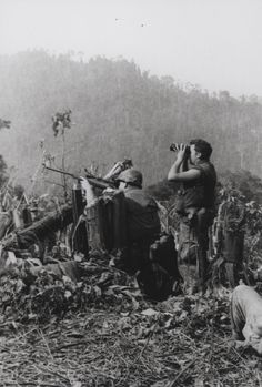 """On Target: A Marine sniper team with 1st Battalion, 9th Marines [1/9] opens fire on the enemy while participating in Operation Dewey Canyon. The multi-battalion offensive thrust in the jungles just northwest of the A Shau Valley netted the Marines 436 enemy killed during the first 30 days of the operation. (Official USMC photo by LCpl D.L. Randolph)."" From the Jonathan F. Abel Collection (COLL/3611), Marine Corps Archives & Special Collections, Quantico, Virginia. OFFICIAL USMC PHOTOGRAPH"