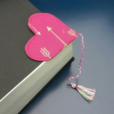 Check out this item in my Etsy shop https://www.etsy.com/uk/listing/479424719/corner-bookmark-with-tassel-hot-pink