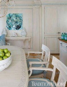 Frieze detailing on the crown molding in the same shade of blue that appears on the chair cushions takes this kitchen to a whole other level. - Traditional Home ® / Photo: Ron Blunt / Design: Mary Douglas Drysdale