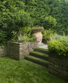 These dry-stacked bluestone walls serve as planters as well as retaining walls.