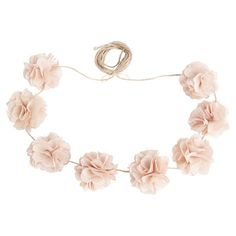 Add a lovely touch to your entryway vignette or living room mantel with this handmade twine garland, showcasing burlap rose accents for charming appeal.