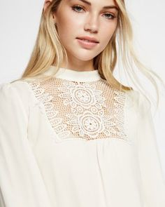 crocheted lace bib mock neck blouse