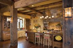 Amazing kitchen in this timberframe/log home. Plenty of space to cook and entertain!