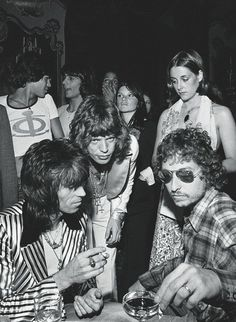 Keith Richards , Mick Jagger , Bob Dylan , Jagger's 29th birthday party in July 1973 photographed by Ken Regan (ROLLINGSTONE)