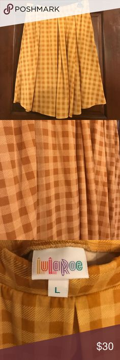 LuLaRoe Madison skirt EUC - perfect for fall! 🍁 This beautiful mustard color Madison skirt is perfect for fall! It pairs so well with brown riding boots and a chambray shirt. It has only been worn once, and was washed gentle cycle and air dried. My favorite part? It has pockets!! From a non-smoking home. Make an offer! LuLaRoe Skirts A-Line or Full