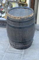 You can faux paint a plastic or metal rain barrel to look like it is made of wood.