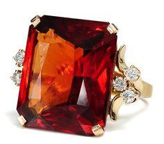 25 carat pyrope garnet, diamond fleur de Lys, .25 ct total weight. What a monster! Modern estate