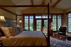 A beautifully simple and rustic master bedroom with plenty of natural light.