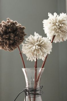 Pom-pom DIY. Pom-poms are so versatile! Fabric or wool ones or even a combination look great as flowers stuck on small branches or as a garland.