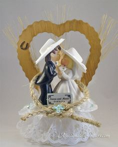Personalized Wedding Cake Topper Features Kissing Hillbilly Redneck Cowgirl Bride and Cowboy Groom In Center Of A Large Wedding Love Knot.