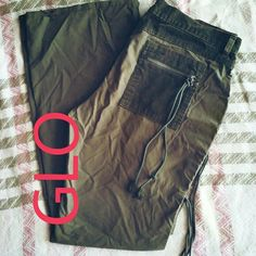 GLO Charcoal Green Cargo Pants 11 Jrs In lovingly worn condition. Everything is great except for the little distressing at the bottom of one pant leg as pictured above. Inseam is 30 inches. Super cute and unique in style. Combination courderoy accents throughput with tassels. Has a special style for that special gal. Size 11 Jrs. GLO Pants
