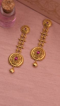 Ornamental design accentuated with vivid hues on the gold earrings Gold Jhumka Earrings, Jewelry Design Earrings, Gold Earrings Designs, Gold Jewellery Design, Necklace Designs, Gold Necklace, Gold Jewelry Simple, Gold Wedding Jewelry, Bridal Jewellery