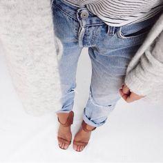 Grey fuzzy cardigan, thing striped shirt, distressed jeans and a chunky heel shoe. Original: mija_mija_ on Instagram