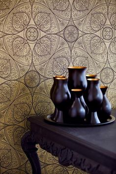 Evocative of a romantic mehndi, this intricate gold wallpaper celebrates the ceremonial art form of a henna tattoo. Black tree of life branches are swirled into a gorgeous geometric medallion print on a glorious gold substrate. Luxury Wallpaper, Gold Wallpaper, Contemporary Wallpaper, Designer Wallpaper, Pattern Wallpaper, Ornament Tapete, Papier Paint, Indian Henna Designs, Indian Patterns