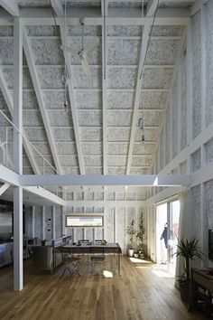 Sabi, a surfers' house in Chiba, Japan, designed by No. 555 architects. The textured walls are painted wood-wool blocks, a combination of recycled wood fiber and cement commonly used as insulation.