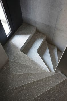 sixty9degrees: Men Duri Arquint Architect. Love the geometric shapes associated with these stairs. The stairs are designed with precast terrazzo.  www.doyledickersonterrazzo.com