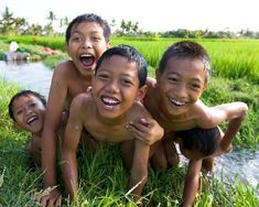 Boys playing in the rice fields, Bali
