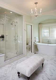 Bathroom. Traditional bathroom with neutral walls and marble herringbone floor tiles. Francesca Owings Interior Design