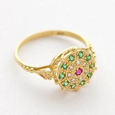 In love with this gold emerald-diamond-ruby ring