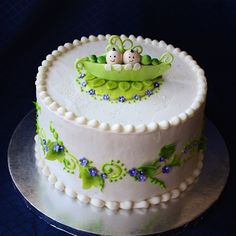 This baby shower cake for twin boys was a fun one to make. This is lemon cake with fresh lemon custard filling and lemon icing. All decorations are fondant or gumpaste.