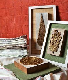 Lovely and unique.....wooden block motifs framed as wallart