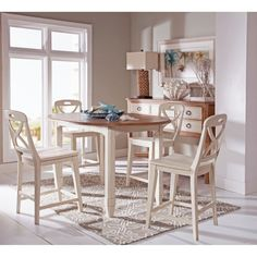 Lend some relaxed country-style flair to your dining area with the Panama Jack Millbrook Round Counter Height Dining Table . This table features a counter-height. Extendable Dining Table Set, Round Dining Table, Patio Bar Set, Pub Table Sets, Kitchen Dining Sets, Dining Room Sets, Room Kitchen, Counter Height Pub Table, Counter Stools