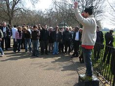 Speaker's Corner, Hyde Park, London. Anyone can bring a soapbox (or whatever they wish to stand on) and speak freely. It's a 150 year old tradition and now... a tourist attraction.