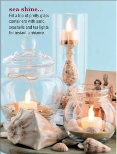 Fill a trio of pretty glass containers with sand, seashells and tea lights for instant ambiance.