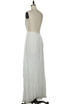 I saw thus dress in summer 2914 at Little Five Points ATL.....but they sold out!  Willow Crochet Lace Open Back Maxi Dress - Ivory
