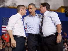 President Barack Obama, center, during a campaign event for U.S. Senate candidate Gary Peters, right, and gubernatorial candidate Mark Schauer, left, at Wayne State University, Saturday, Nov. 1, 2014 in Detroit, Mich. (AP Photo/Pablo Martinez Monsivais)