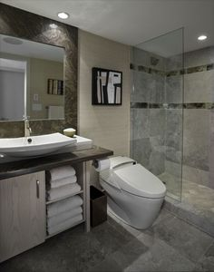 Minus the vanity (that space doesn't exist) add small handbasin to wall opposite shower.