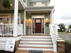 Green house, white porch (Seaside Interiors: Parade of Homes Inspiration)