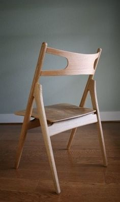 Wegner Sawbuck Chair. Simple beauty: http://www.danishdesignstore.com/products/ch29-sawbuck-chair-by-hans-j-wegner