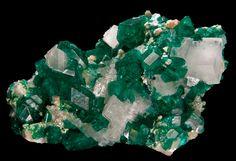 Dioptase with calcite and Minrecordite, CaZn(CO3)2,Tsumeb Mine (Tsumcorp Mine), Tsumeb, Otjikoto (Oshikoto) Region, Namibia. Size 5.5x4cm