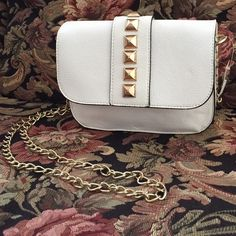 Forever 21✨Studded Crossbody Bag Cream gold studded bag. Clean inside and out. Small indent as seen in pic 4. It is barely noticeable, but wanted to point it out. Just the right size for a night out. Forever 21 Bags Crossbody Bags