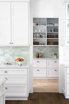 This beautiful home shows how to decorate your home in the Hamptons style with a classic Hamptons kitchen and living room filled with coastal decorating ideas Shaker Style Cabinetry, Hamptons Style Homes, Kitchen Decor, Hamptons Kitchen, Home Kitchens, Country Style Homes, Country House Decor, Kitchen Design, House And Home Magazine
