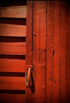 Paprika-colored door and interior architecture