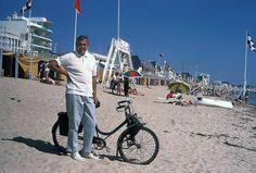 Jacques Tati on a beach with a 'Solex', circa 1960, France