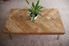 Handmade coffee table made of repurposed wood. Herringbone design and hairpin legs. Made to order, custom woodworking. ***If being shipped, customer will need to screw on the legs. Pre-drilled holes and all hardware will be included***  Dimensions are L: 45 W:24.5 H:17