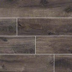 Move over hardwood! Wood look porcelain tile is taking center stage. These new stars offer the look and feel of genuine wood - even some saw marks in a spectrum of styles from reclaimed rustic to modern gray-washed. Choose these stunning yet durable tiles to headline your design! Featured: Country River Moss